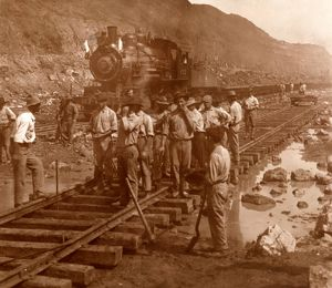 Spanish laborers at work in Culebra Cut and loaded train hauling dirt from canal